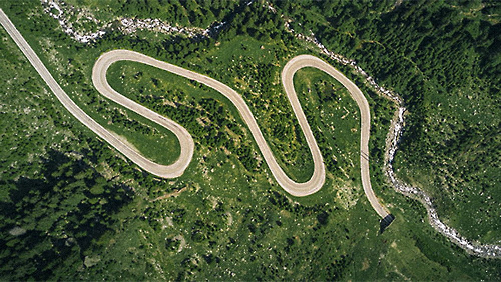 arial photo of a winding road in the mountains